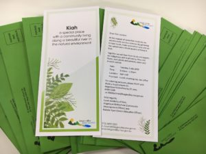Kiah Community Day Invitation showing green envelopes and a two page brochure
